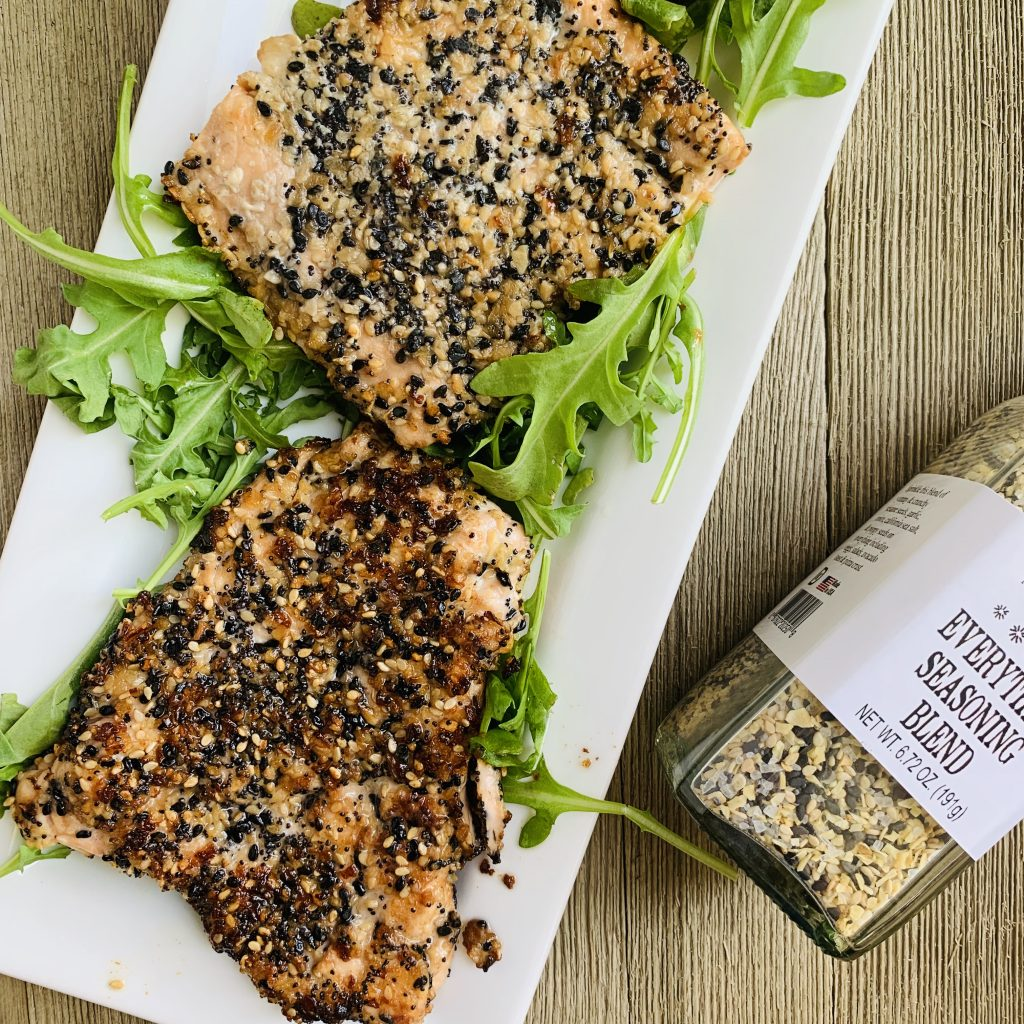 Everything Bagel Seasoning crusted salmon. This flavorful seasoning goes all around the filet, which is then seared on stove top and baked to perfection.